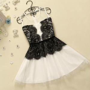Sweet net yarn stitching lace vest ..